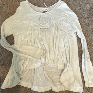 Asymmetric white blouse with lace